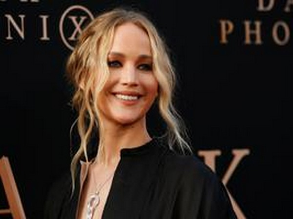 "Jennifer Lawrence poses at the premiere for the film ""Dark Phoenix"""