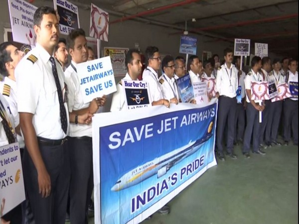 Jet Airways employees staging a silent protest at Mumbai International Airport on Wednesday. (Photo/ANI)