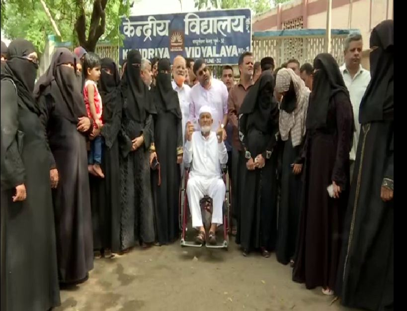 Haji Ibrahim Saleem Joad with his family members at a polling booth at Pune on Monday