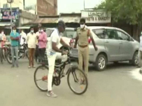 YSR Kadapa district Superintendent of Police KK Anburajan inspects the city on cycle on Wednesday (Photo/ANI)