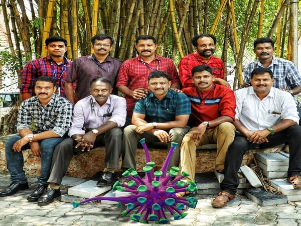 Social Media team of Kerala Police in front of Coronavirus model they used in an animation video.