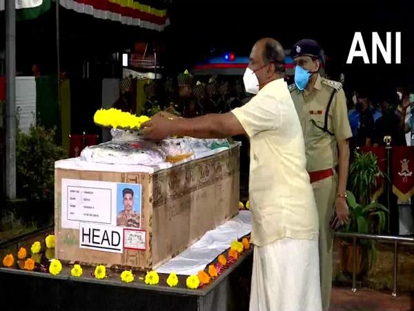 Kerala Finance Minister KN Balagopal pays tribue to Sepoy Vaisakh H in Thiruvananthapuram (Photo/ANI)