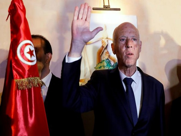 Tunisian presidential candidate Kais Saied reacts after exit poll results were announced on Sunday (Reuters)