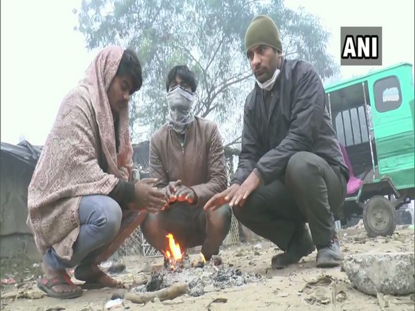People in Varanasi lit up fire to keep themselves warm (Photo ANI)