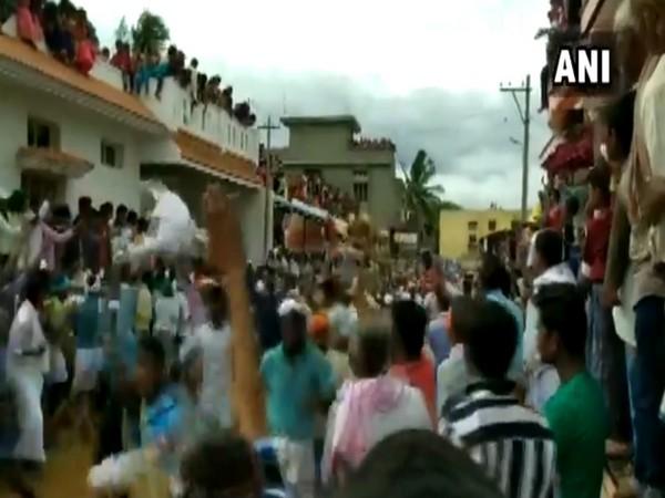 People celebrating 'Kara Hunnime' in Karjagi village, Karnataka on Thursday.