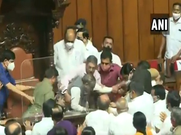 Congress MLCs in Karnataka Assembly forcefully remove the chairman of the legislative council on Tuesday. (Photo/ANI)