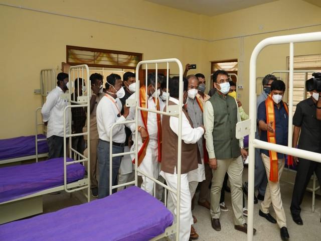 Visual of Karnataka Deputy Chief Minister Dr CN Ashwathnarayan at Covid Care centre with other officials (Photo/ANI)