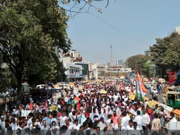 Karnataka Congress on Saturday took out a protest march near the CM's office in Bengaluru. Photo/ANI