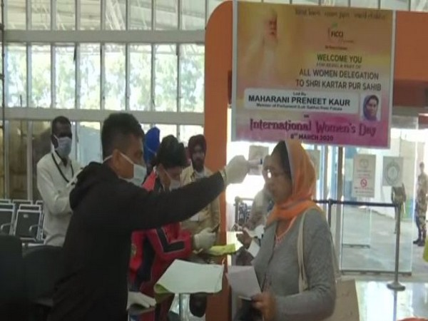 Devotees being checked for their temperature in the wake of coronavirus. Photo/ANI