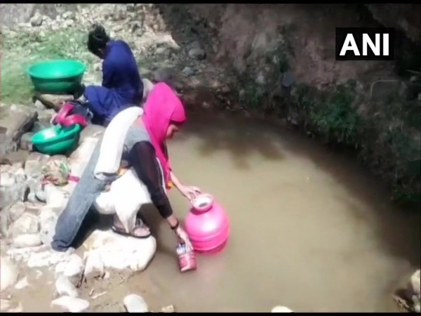 Villagers drawing water from the polluted nullah in Kathua, Jammu and Kashmir