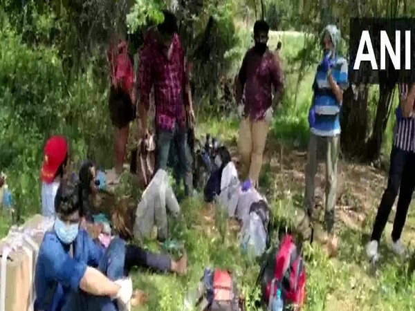 Keralites who were stranded as the government did not allow them to enter the state for failing to produce necessary passes. Photo/ANI