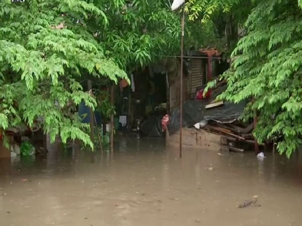 Houses adjoining to Mutha river flooded after Khadakvasla dam released water due to heavy rainfall. Photo/ANI