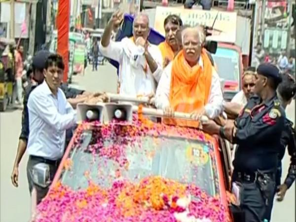 Haryana Chief Minister Manohar Lal Kattar on roadshow in Kurukshetra on Thursday. Photo/ANI