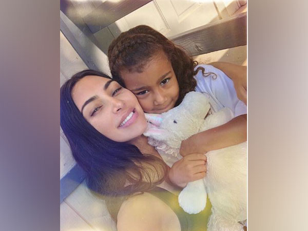 Kim Kardashian along with daughter North West (image courtesy: Instagram)