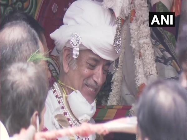 Former King of Puri Gajapati Maharaja Dibyasingha Deb on the chariot performing 'Chhera Pahanra' ritual in Puri, Odisha here on Tuesday. (Photo/ANI)