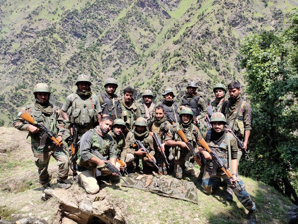 Security force personnel with the recovered arms and ammunition from the operation in Kishtwar