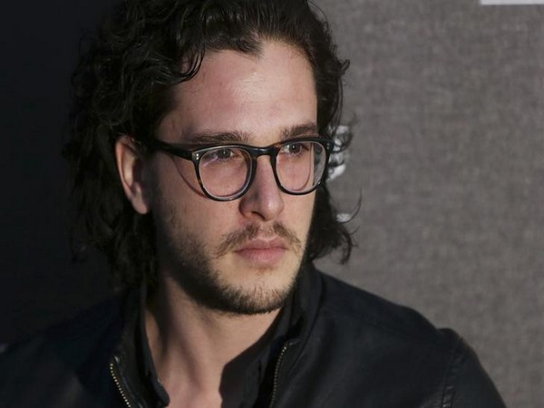 Kit Harington poses for photographers at the Battersea Power Station Annual Party in London
