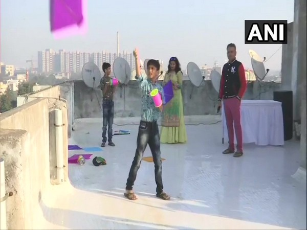 Children flying kites on a terrace on the ocassion of Uttarayan in Ahmedabad, Gujarat on Tuesday Photo/ANI