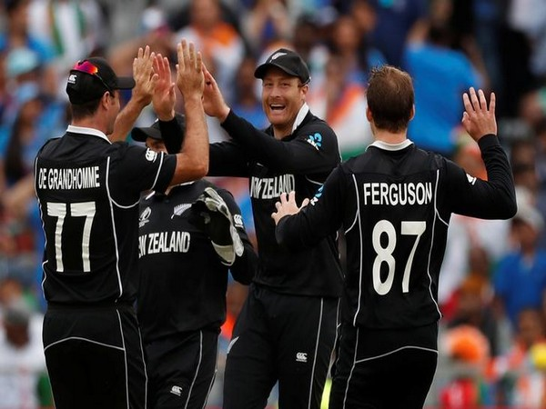 New Zealand players celebrating after taking a wicket in the semifinal against India.