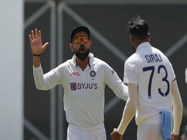 India skipper Virat Kohli and Mohammed Siraj (Image: BCCI)