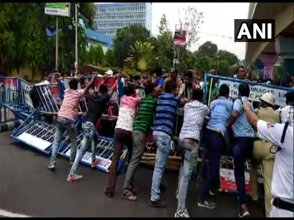 Teachers protest in front of Bikash Bhavan in Kolkata on Monday