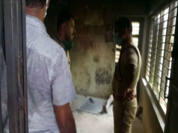 Police officials at the bank in Kollam, Kerala where the woman committed suicide on Wednesday. Photo/ANI