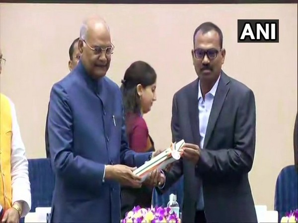 President Ram Nath Kovind presenting National Award to a teacher at Rashtrapati Bhawan on Thursday. (Photo/ANI)