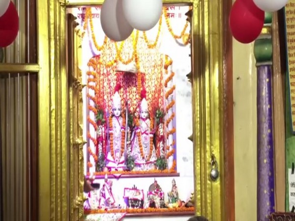An idol of lord Krishna and Radha decorated with Garlands in Ayodhya temple