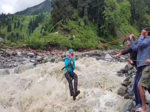 Tourists being rescued by the local team on Sunday. Photo/ANI