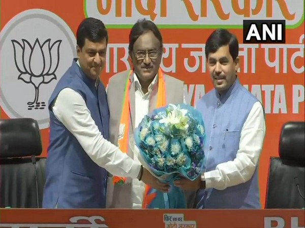 Congress leader Dr S Krishna Kumar joining BJP in presence of Union Minister Shahnawaz Hussain and party leader Anil Baluni on Saturday in New Delhi.