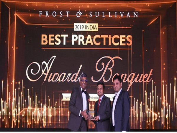Abhishek Sinha, COO and Board Member, L&T Technology Services receives the Award from Mr. Anand S, Vice President, Frost and Sullivan