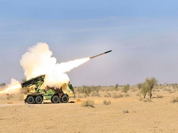 Pinaka multi-barrel rocket launcher firing.
