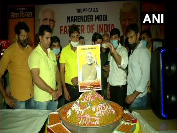 BJP workers celebrated Prime Minister Narendra Modi's 70th birthday at India Gate. (Photo/ANI)