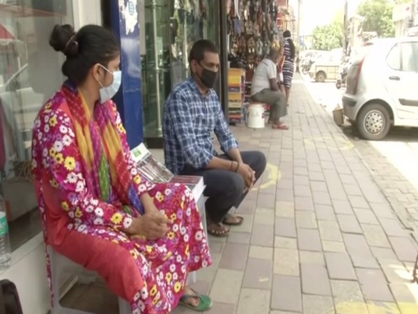 Mehndi artists waiting for customers in view of Eid-ul-Fitr festival in Delhi's Lajpat Nagar on Sunday. Photo/ANI