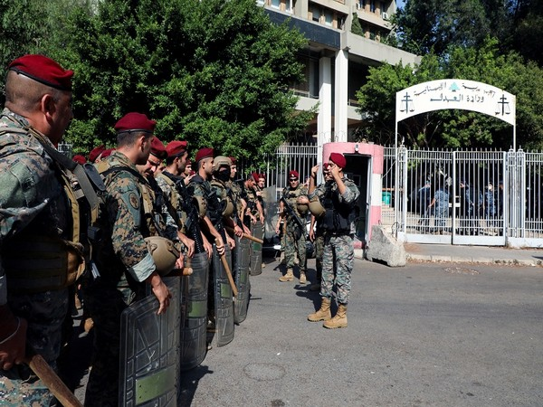 Army soldiers stand guard ahead of a protest in Beirut. (Photo Credit - Reuters)