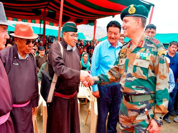 Lieutenant General YK Joshi interacting with attendees at ex-servicemen rally on Wednesday. Photo/ANI