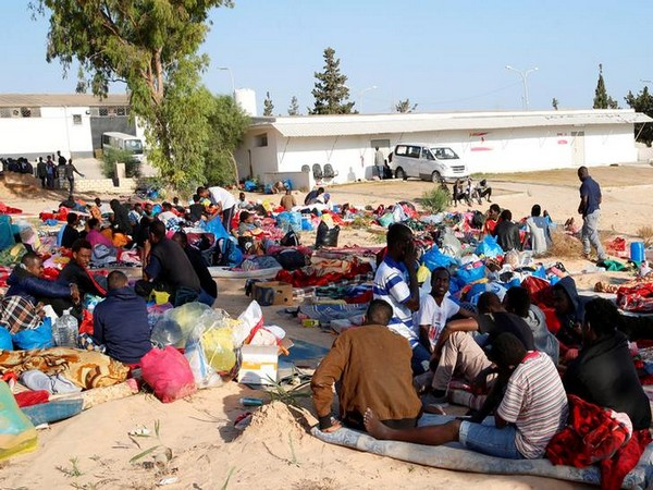 Migrants are seen with their belongings at the yard of a detention centre for mainly African migrants, hit by an airstrike, in the Tajoura suburb of Tripoli, Libya, on July 3
