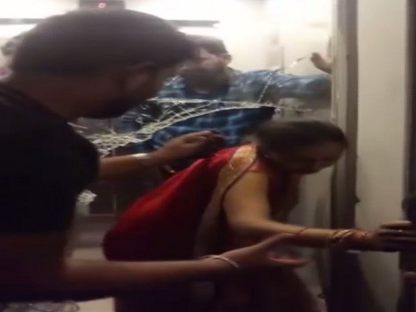 A women being rescued from the lift in a hotel in Patna.