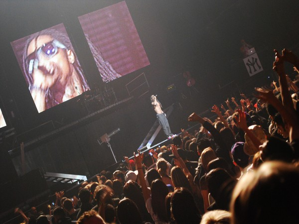 Lil Wayne performing at a concert