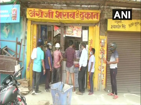 People queue up outside liquor shops in Varanasi. (Photo/ANI)
