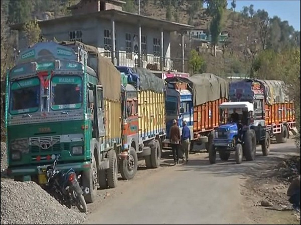 Indian trucks carrying trade commodities waiting to cross over to PoK side. (file photo)