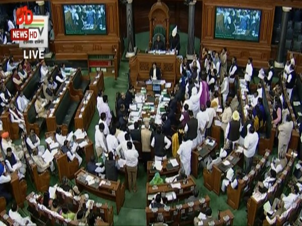 Opposition members raises slogans in Lok Sabha on Monday demanding release of NC leader Farooq Abdullah.