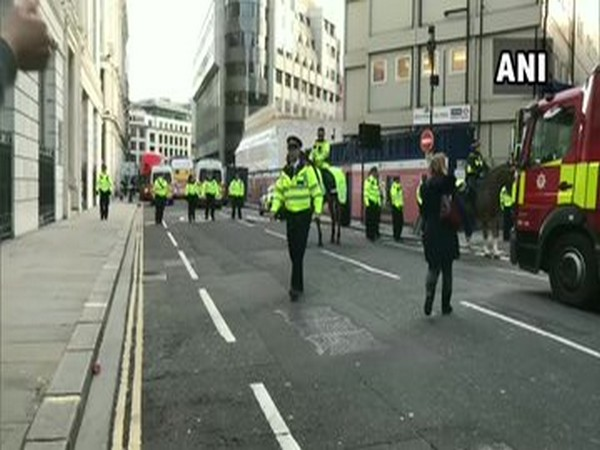Police at the spot after a male suspect stabbed several people in London Bridge on Friday.