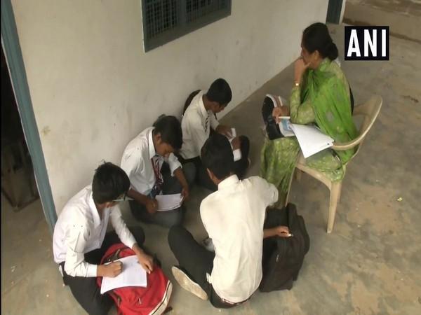 Students studying in hallways in Jawahar Nagar Boys Government Senior Secondary School