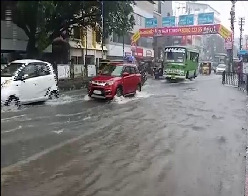 MG Road in the city was flooded due to heavy rains. Photo/ANI