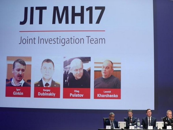 Russian nationals suspected of the downing of flight MH17, are shown on screen as international investigators present their latest findings on Wednesday
