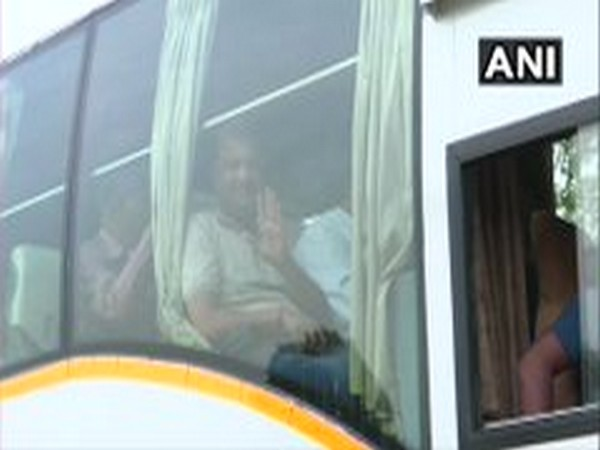 Congress MLA while posing from the bus, which leaves for Ratnagiri on Friday morning. Photo/ANI