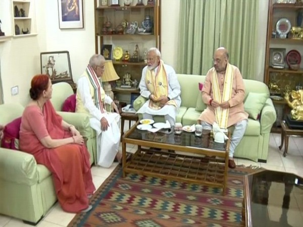 Prime Minister Narendra Modi and Amit Shah meeting Prof MM Joshi at his residence on Friday in New Delhi. Photo/ANI