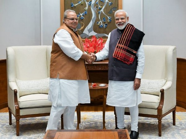Prime Minister Narendra Modi with Satya Pal Malik on Saturday in New Delhi. Photo/PMO official Twitter account