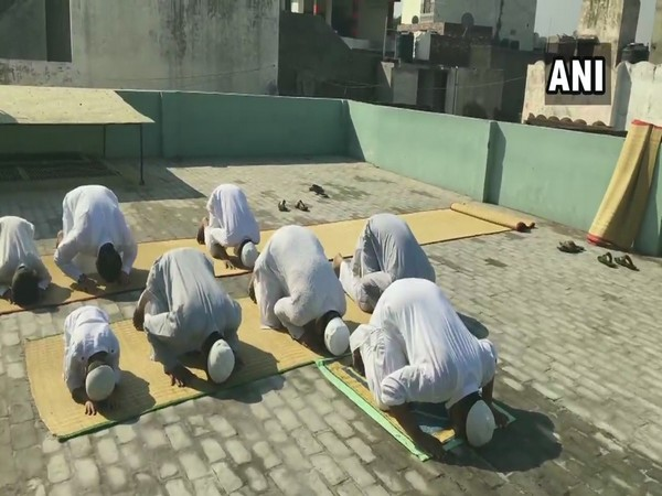 People celebrate Eid-ul-Fitr at their homes in Moradabad. Photo/ANI